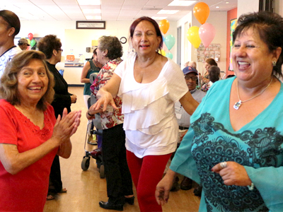 From left, Dulce Castillo, Diana Veronica Benavides and Amailia Jauregui, share the fun at the Fiesta Dance for seniors at the Fruitvale-San Antonio Senior Center in Oakland, which was co-hosted by the Center for Elders' Independence and The Unity Council.