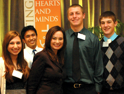 Rosie Rios, treasurer of the United States, poses with students of Moreau Catholic High School in Hayward.